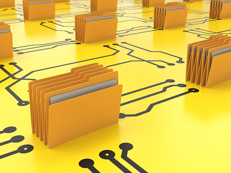 Yellow files on top of a yellow table with black lines on it